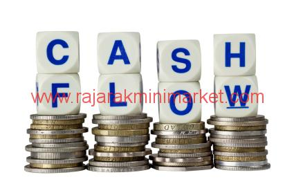 Stacks of coins with the word CASH FLOW isolated on white background